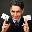 Young lucky gambler with cards — Stock Photo #9804120