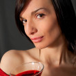 Young woman with wine in glass — Stock Photo