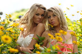 Young Friends In Yellow Spring Flowers — Stock Photo