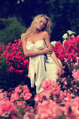 Sexy Blonde Posing Amonst Flowers — Stock Photo
