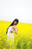 Pretty Woman In Yellow Rape Field — Stock Photo