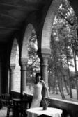 Glamorous Woman On Arched Verandah — Stock Photo