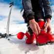Stock Photo: Getting ready for skiing - fastening boots