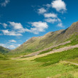 Green mountains under blue sky, Scotland — Stock Photo