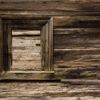 Window of damaged wooden lodge — Stock Photo #9283088