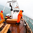 Royalty-Free Stock Photo: Wearing orange coats on fishing boat