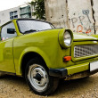 Stock Photo: East-Germplastic vintage car parked near Berlin wall