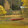 Autumn scenery with cabin and boat — Stock Photo