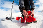 Getting ready for skiing - fastening the boots — 图库照片