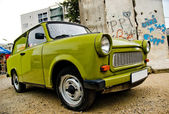 East-German plastic vintage car parked near Berlin wall — Stock Photo