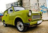 East-German plastic vintage car parked near Berlin wall — Stock Photo