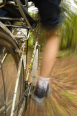 Riding bike off-road, point of view — Stock Photo