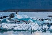 Glacier lake in Iceland - anazing shapes created by global warming — Stock Photo
