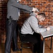 Stock Photo: Police interrogated suspect