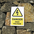 Stock Photo: High voltage danger yellow sign