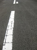 White line on asphalt — ストック写真