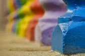 Colorful cement posts — Stock Photo