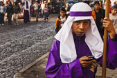 Purple robed boy on cell phone — Stock Photo