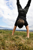 Boy doing a handstand — Stock Photo