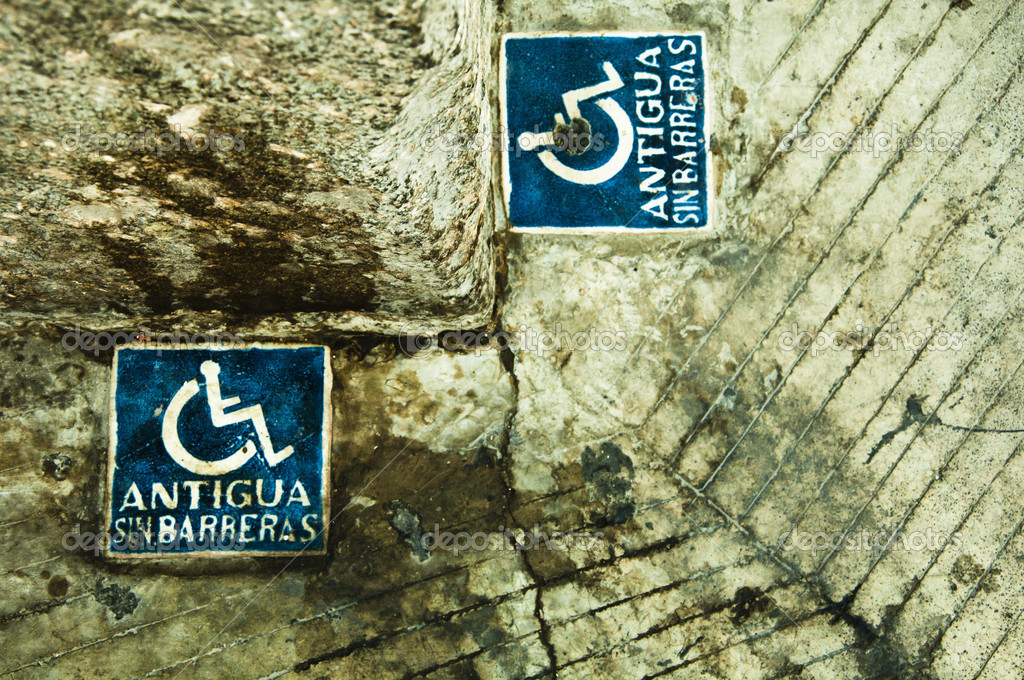 A corner in the city displays two disable signs. — Stock Photo #8829636