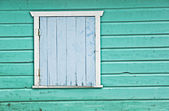 Aged colored wood wall with door — Stock Photo