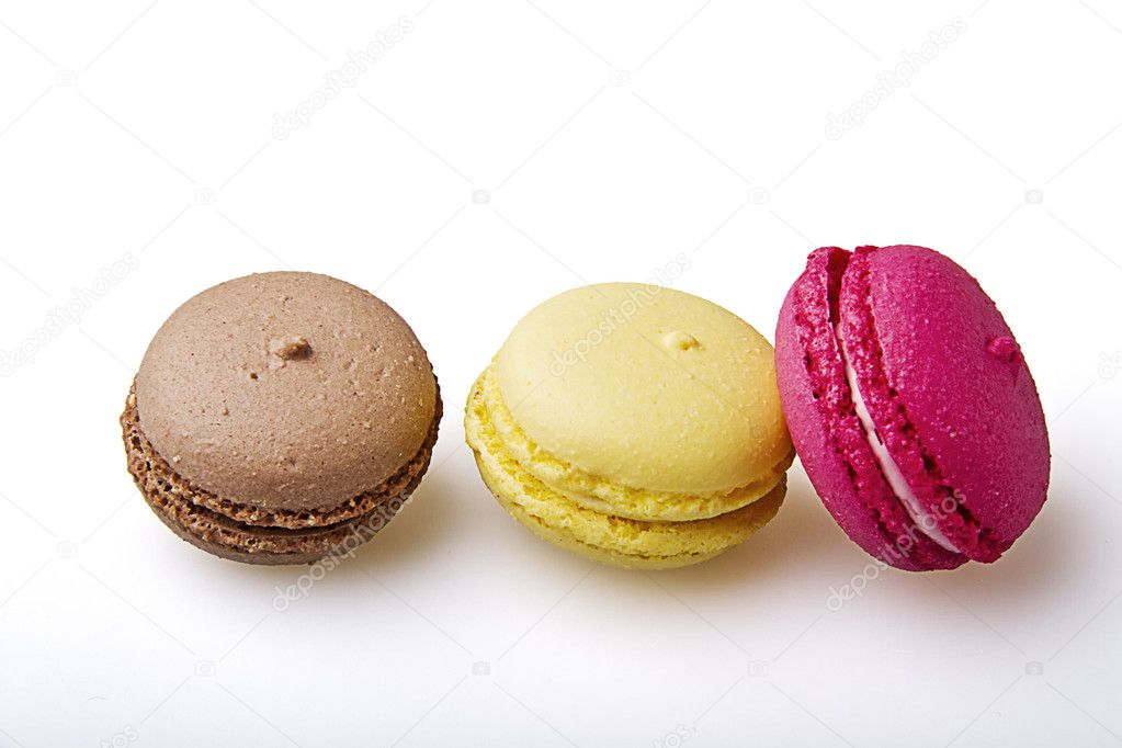 Three tasty macaroons on a white background  Stock Photo #8687152