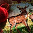 Stock Photo: Old embroidery with a deer