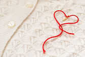 Red heart on a white blouse — Stock Photo