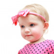 Baby with pink bow — Stock Photo