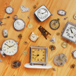 图库照片: Old mechanical clocks and watch parts