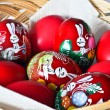 Easter basket with red eggs - Stock Photo