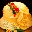 Yellow hat with roses - Stock Photo