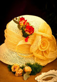 Yellow hat with roses — Stock Photo