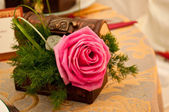Rose in box and decorations at wedding — Stock Photo