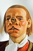 Mythological figure of wax with two noses and three eyes — Stock Photo