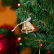 Stock Photo: Bell decoration in Christmas tree.