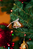 Bell decoration in a Christmas tree. — Stock Photo