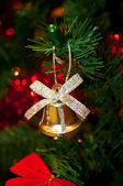 Bell decoration on Christmas tree — Stock Photo