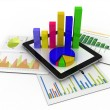 Tablet showing a spreadsheet and a paper with statistic charts, - Stock Photo