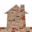 The brick wall and the house conceptually — Stock Photo