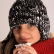 Woman with a warm hood with hot tea - ストック写真