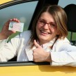 Young girl with driver licence — Stock Photo