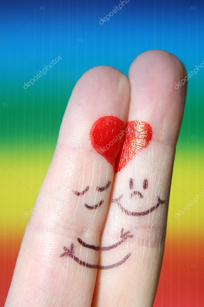 A happy couple in love with painted smiley and hugging  — Stock Photo #8845743