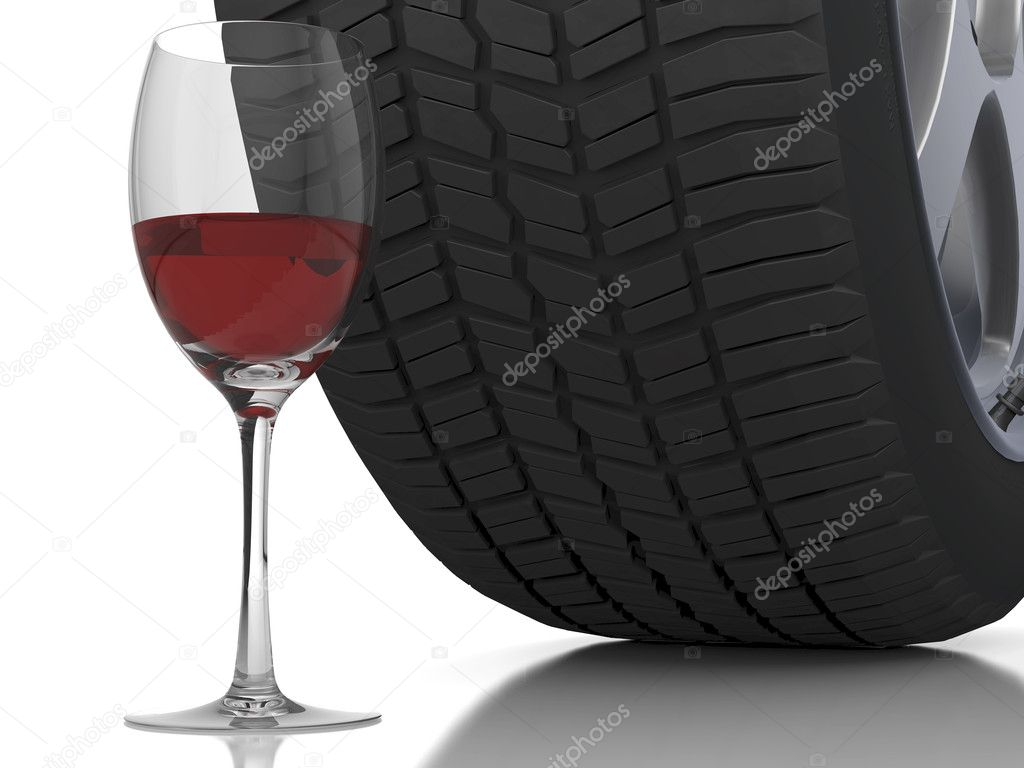 Wine glass with a car wheel in the back ground — Stock Photo #8497587