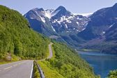 Scenic road by fjord — Stock Photo