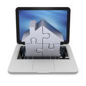 Home jigsaw on laptop — Stock Photo