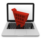 Shopping trolley on laptop — Stock Photo
