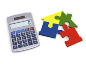 Calculator with house puzzle — Stock Photo