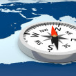 Stock Photo: Compass on world map