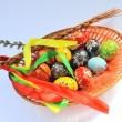 Stock Photo: Easter eggs in wicker basket